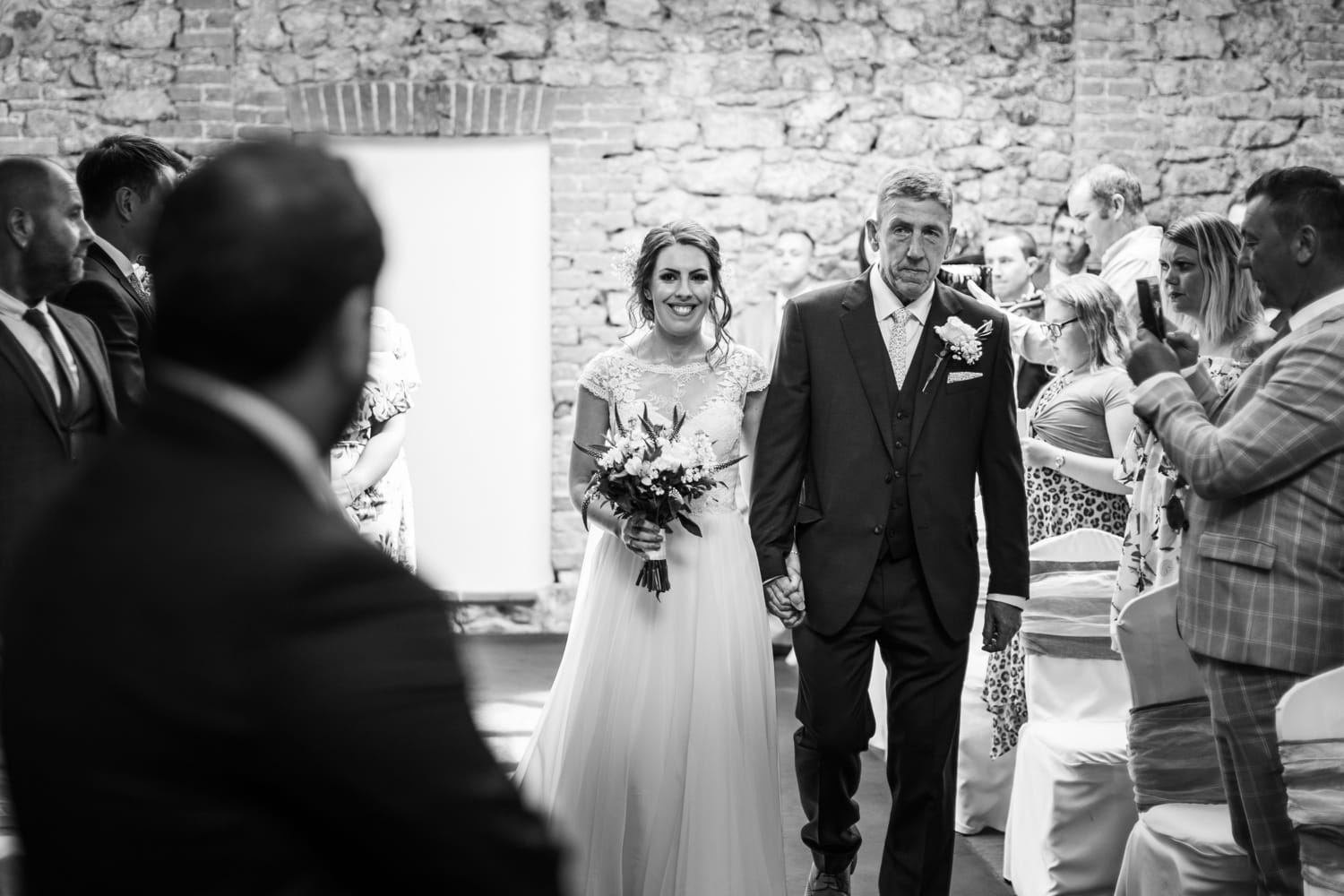 father walks bride down aisle at Oxwich Bay Hotel