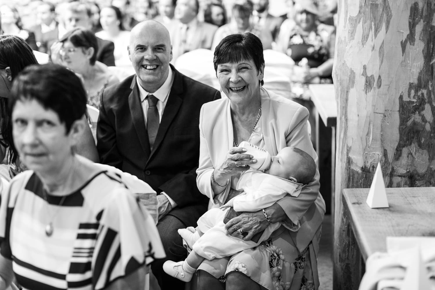 Baby gets fed during wedding ceremony