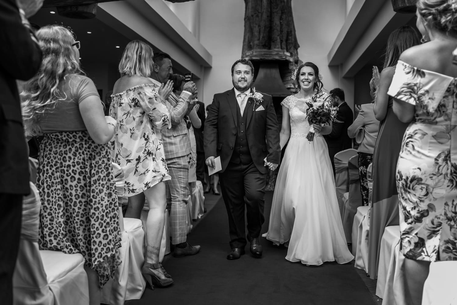 bride and groom walks down aisle