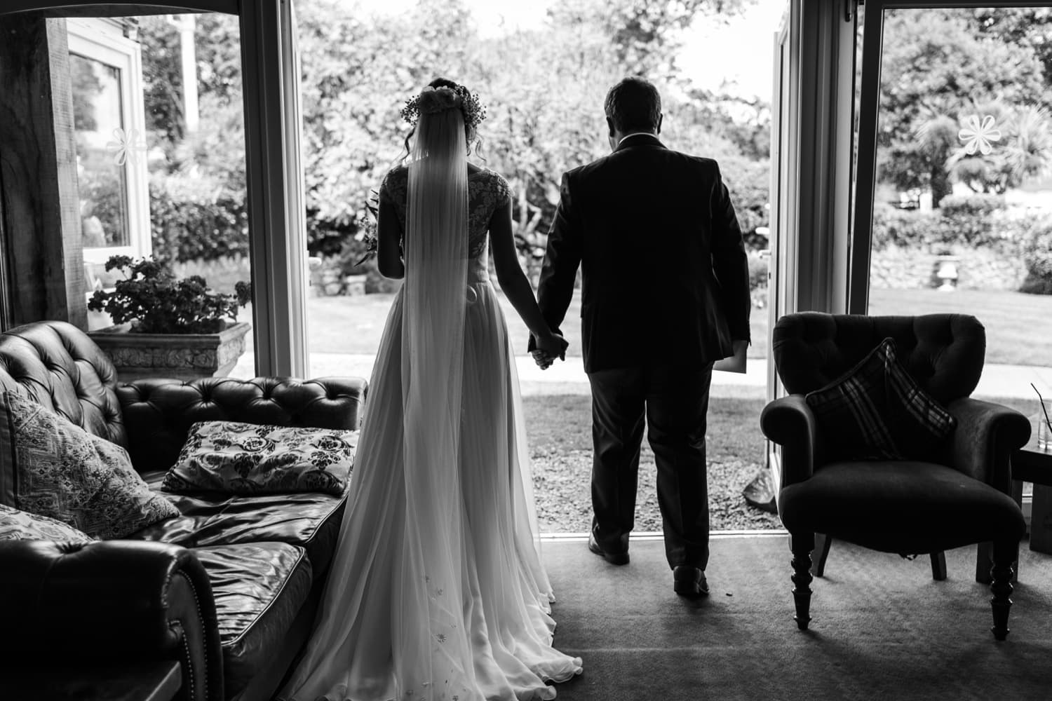 back view of bride and groom through doorway