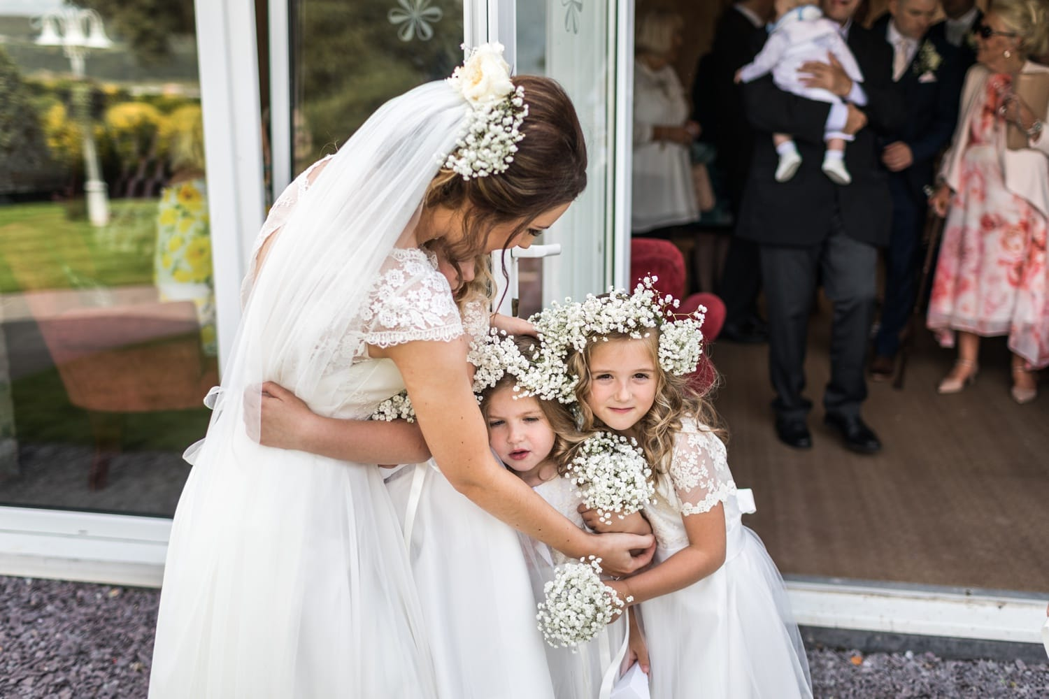 flower girls hug bride