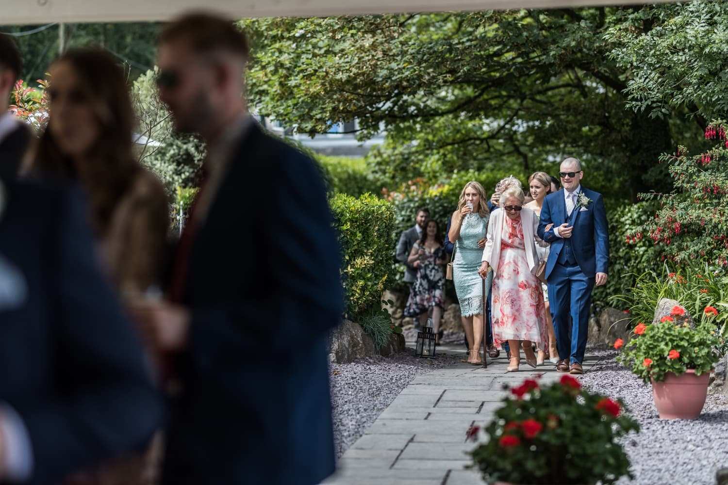 wedding guest arrive at marquee at Oxwich Bay Hotel
