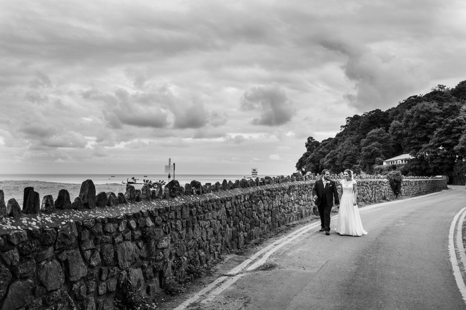 bride and groom walk to beach at