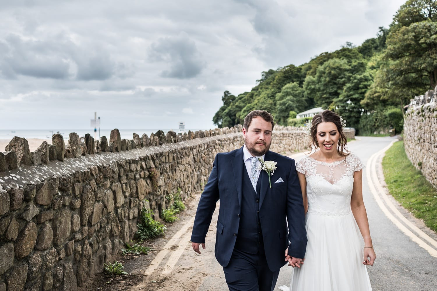 Bride and groom wedding photograpohs on beach at Oxwich Bay in Gower