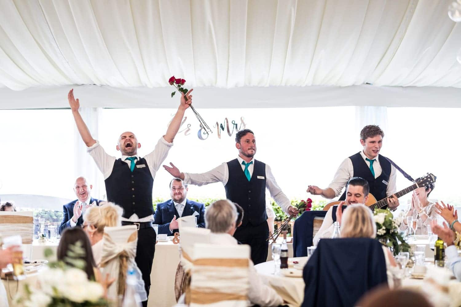 Wedding day singing waiters