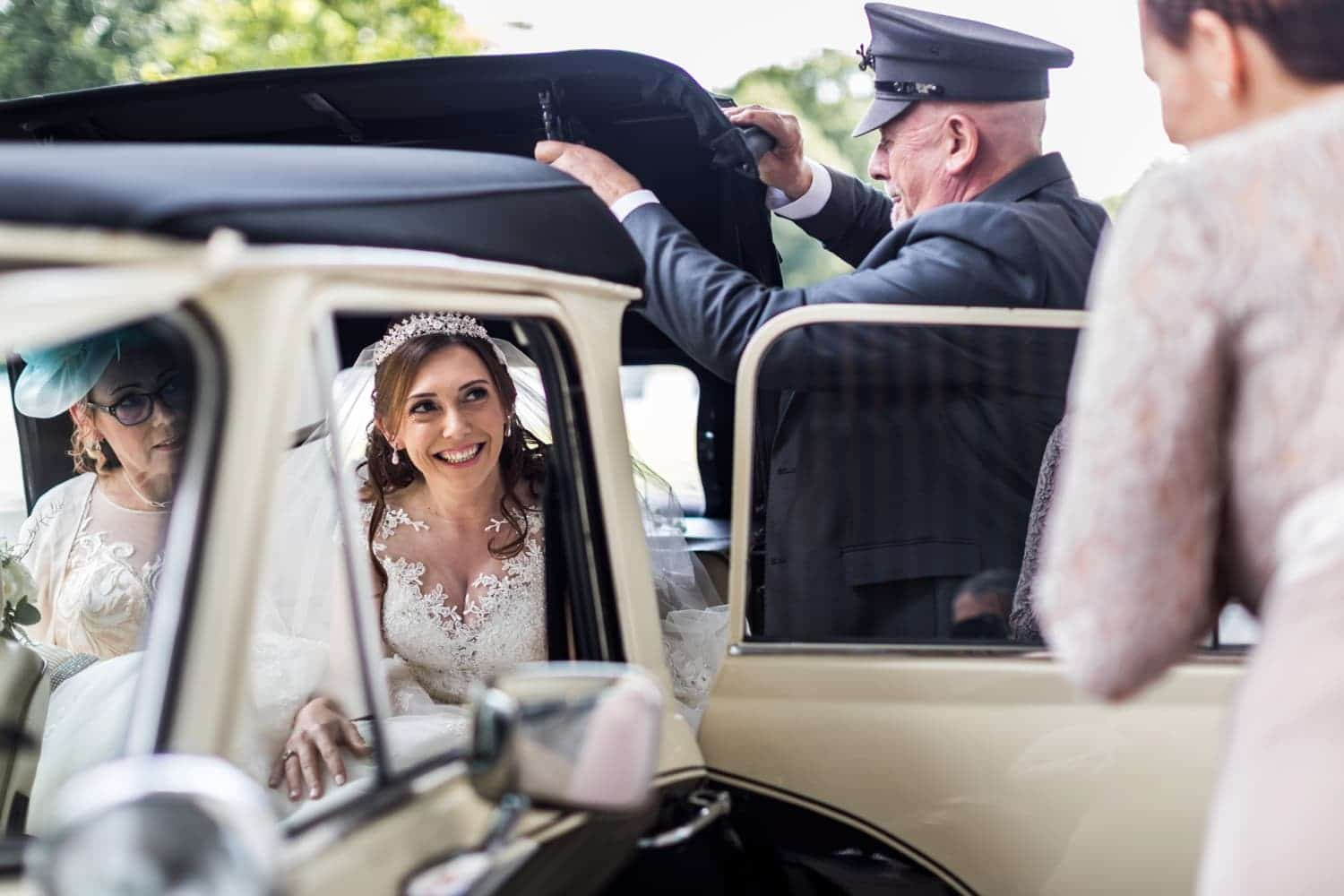 Bride arrives in car for wedding at The Royal Welsh College of Music and Drama