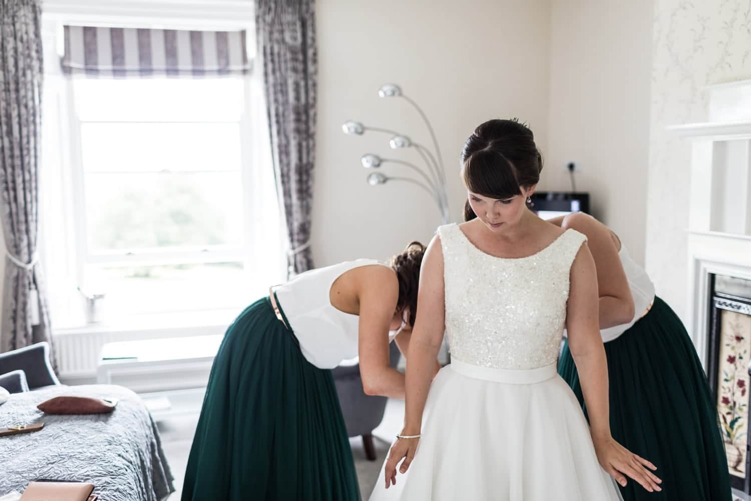 Bride getting dressed at Conrah Hotel