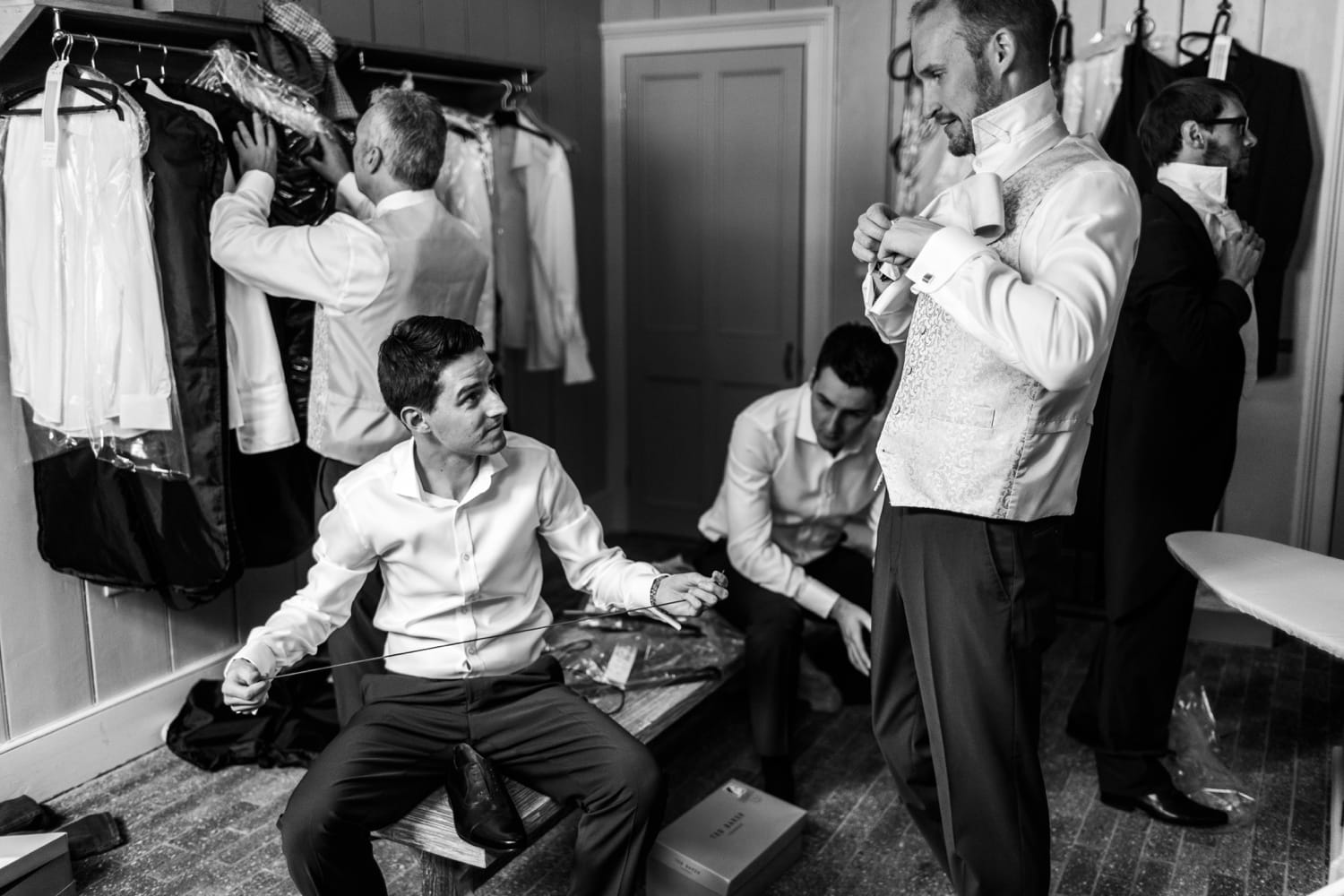 Groom an dushers getting dressed in Mid Wales