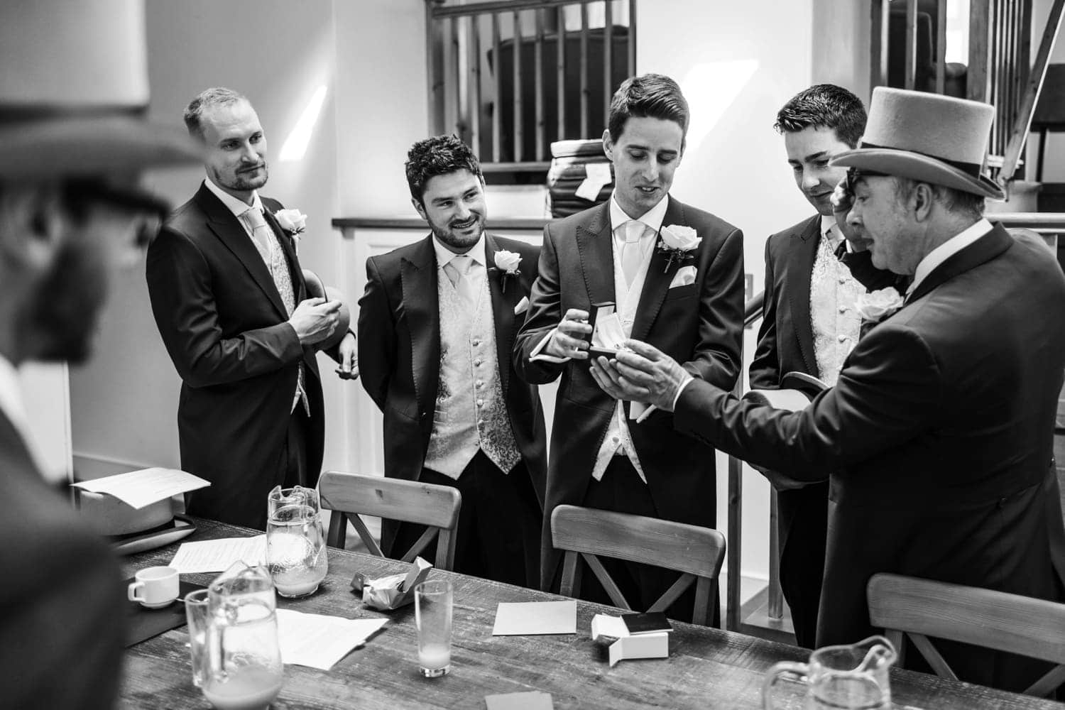 Groom and ushers dressing in Nanteos, Mid Wales