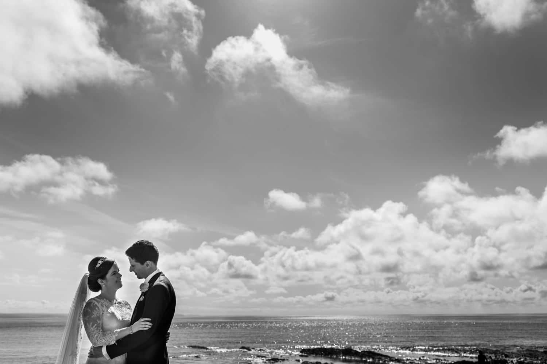 wedding day portraits at Aberystwyth beach in Mid Wales