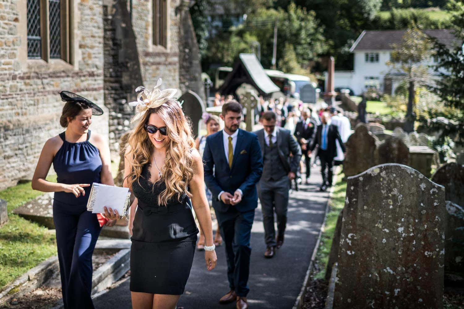 Wedding guests walking t St Catwgs Church in Pentyrch, South Wales