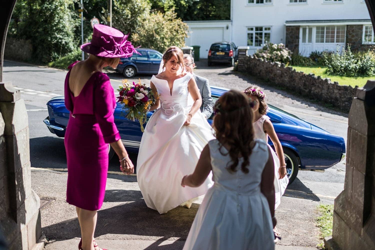 Bride arrives for wedding at St Catwgs Church in Pentyrch, South Wales