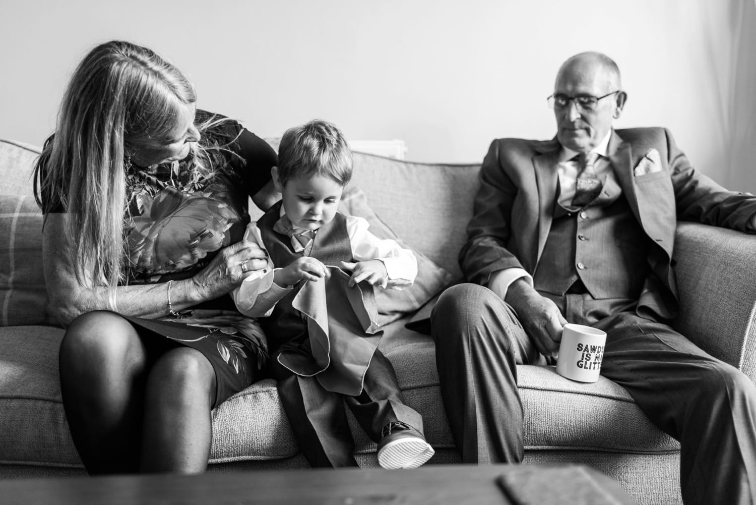 Page boy and parents at same sex wedding