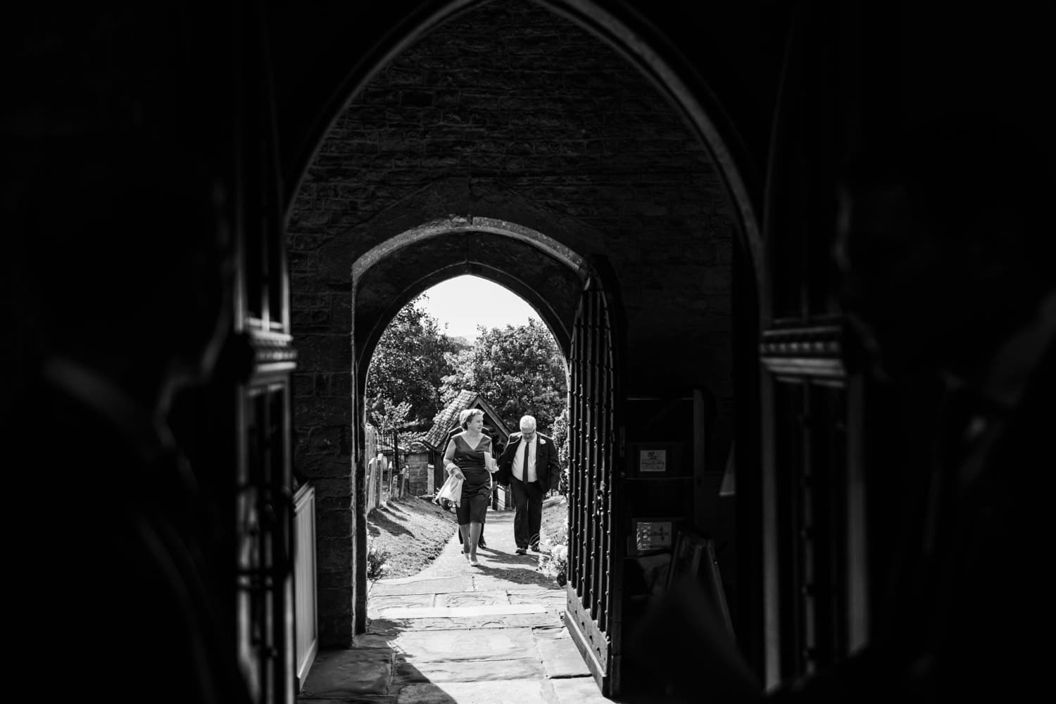 Wedding guests arriving at St Andrews Church in Clevedon, Somerset