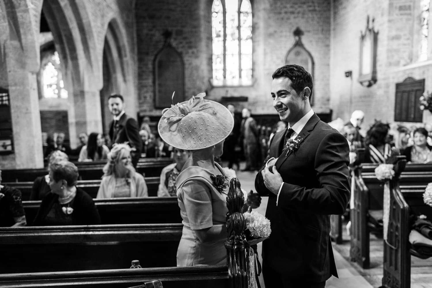 Groom waiting at St Andrews Church in Clevedon, Somerset