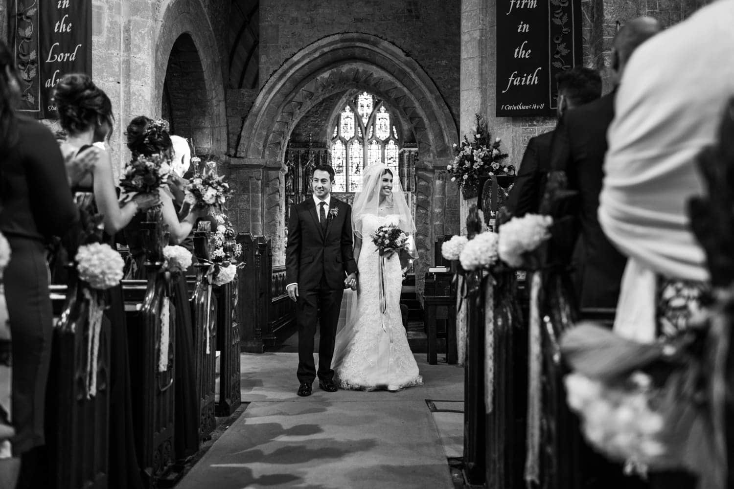 Bride and groom walking down the aisle at St Andrews Church in Clevedon, Somerset