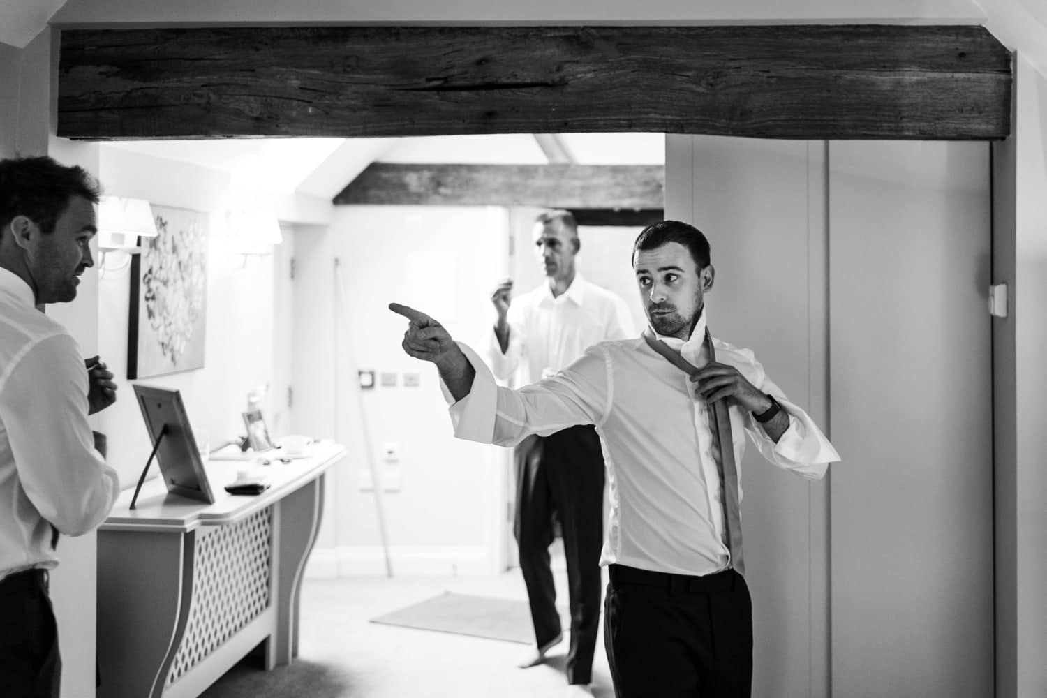 Groom getting ready for wedding at Curradine Barns