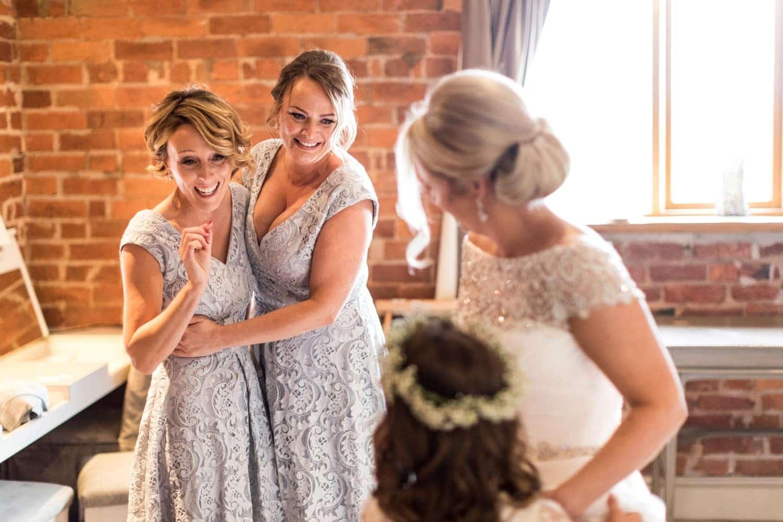 Bride getting ready for wedding at Curradine Barns