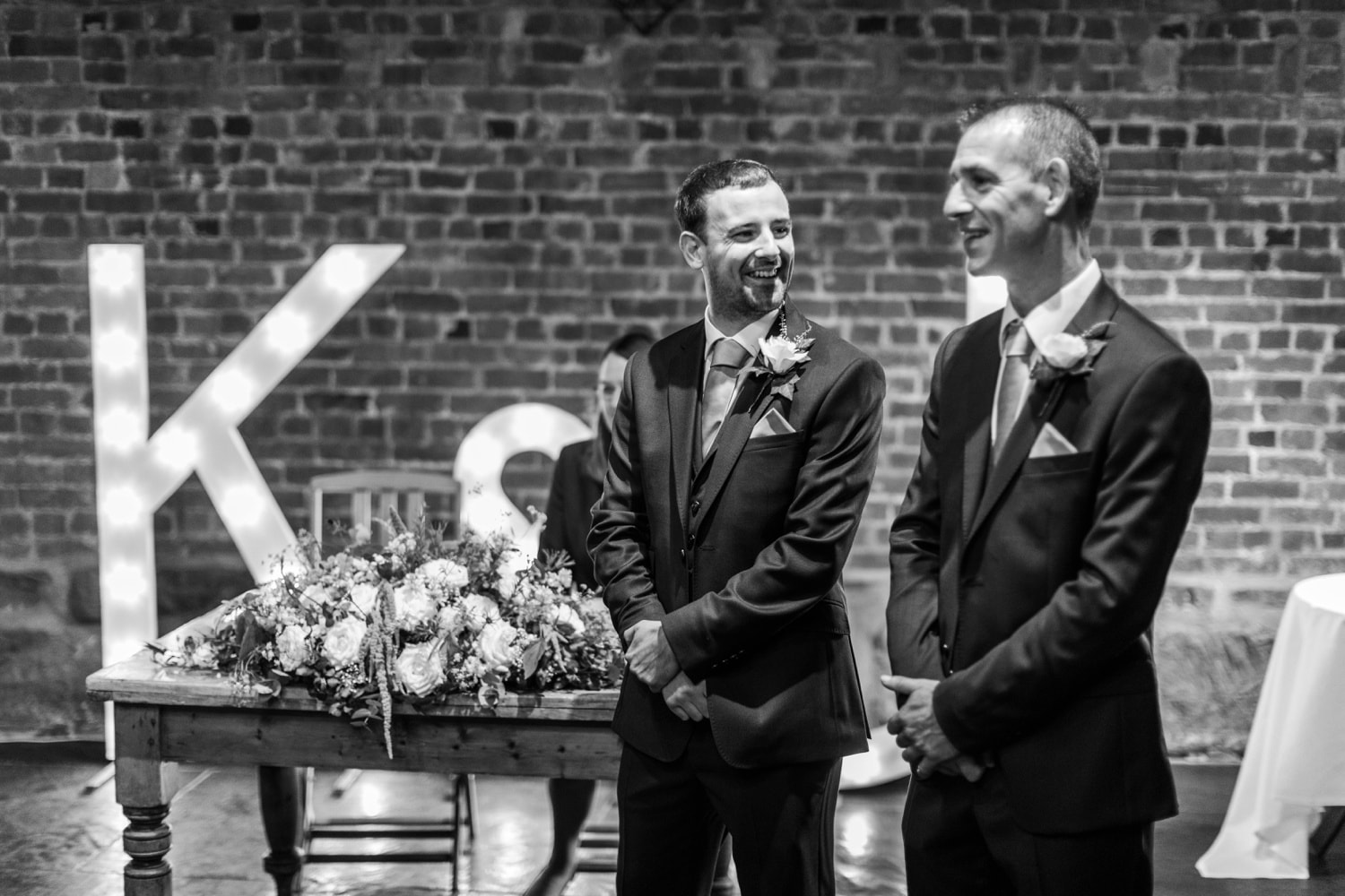 Groom and bestman waiting for brides arrival