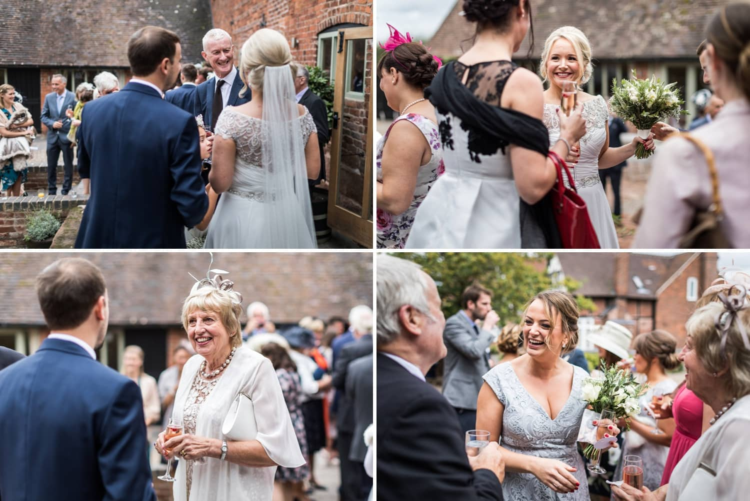 Wedding guests congratulate the bride and groom at Curradine Barns