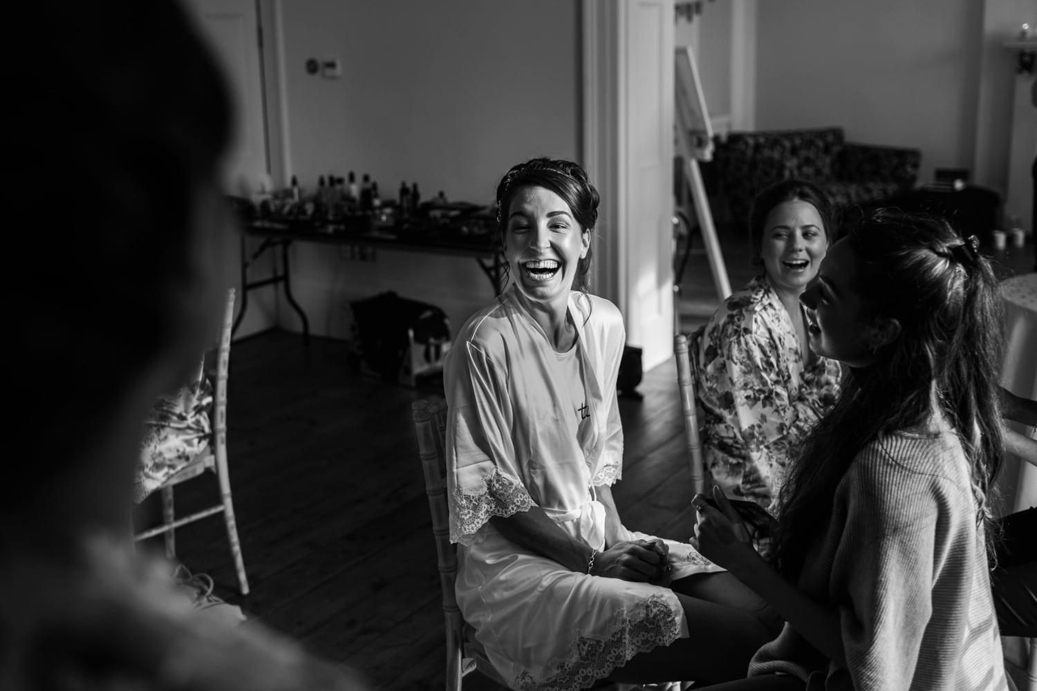Bride in dressing gown, laughing