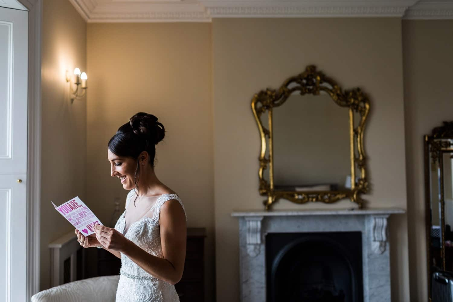 Bride reading card from groom just before wedding