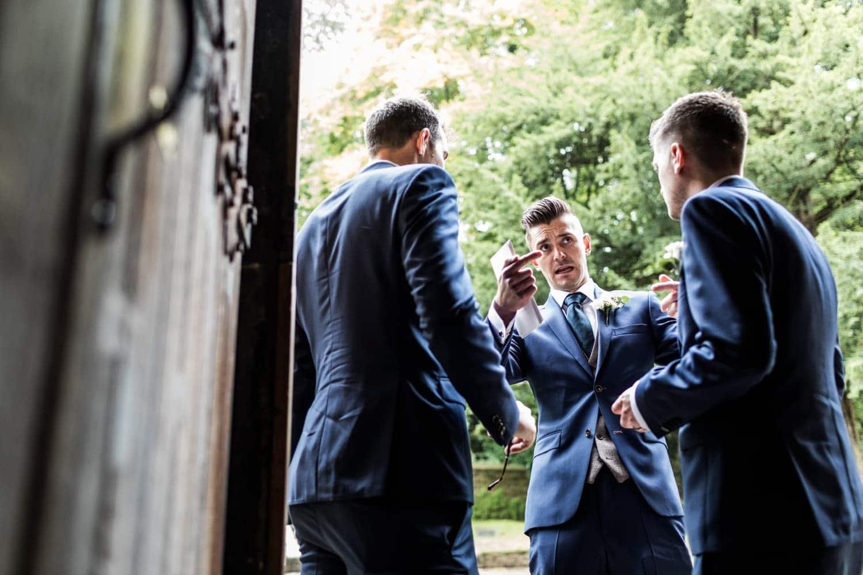 Ushers debate at church wedding