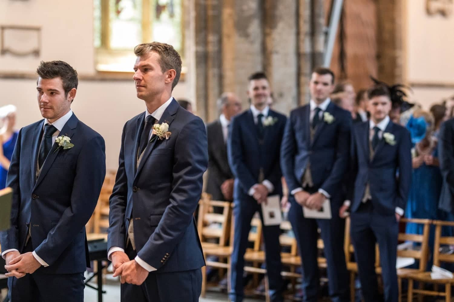 Groom waits at church alter for bride