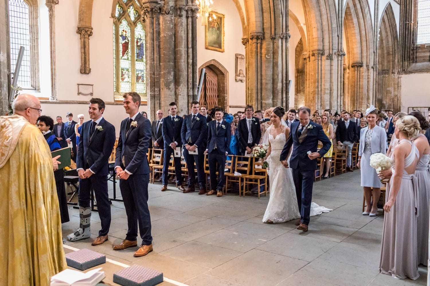 Matt Rowe waiting at alter for Dani King for their wedding at Llandaff Cathedral