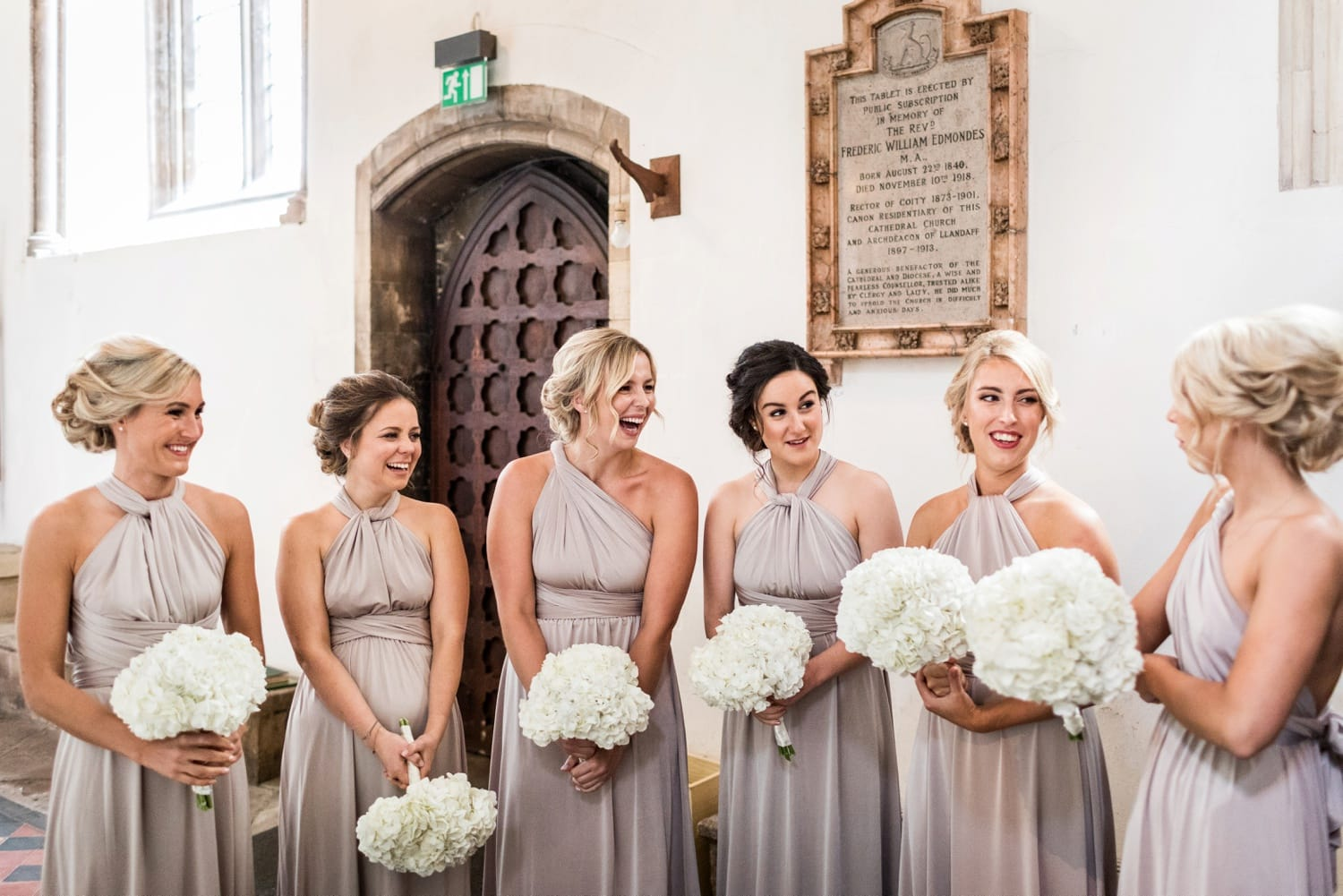 Bridesmaids with white flowers