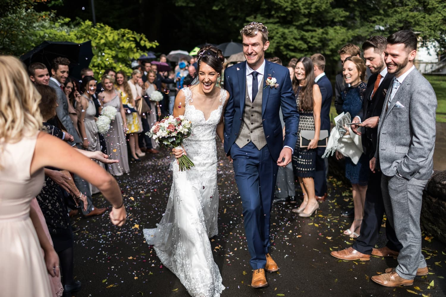 Bride and groom with confetti at Llandaff Cathedral