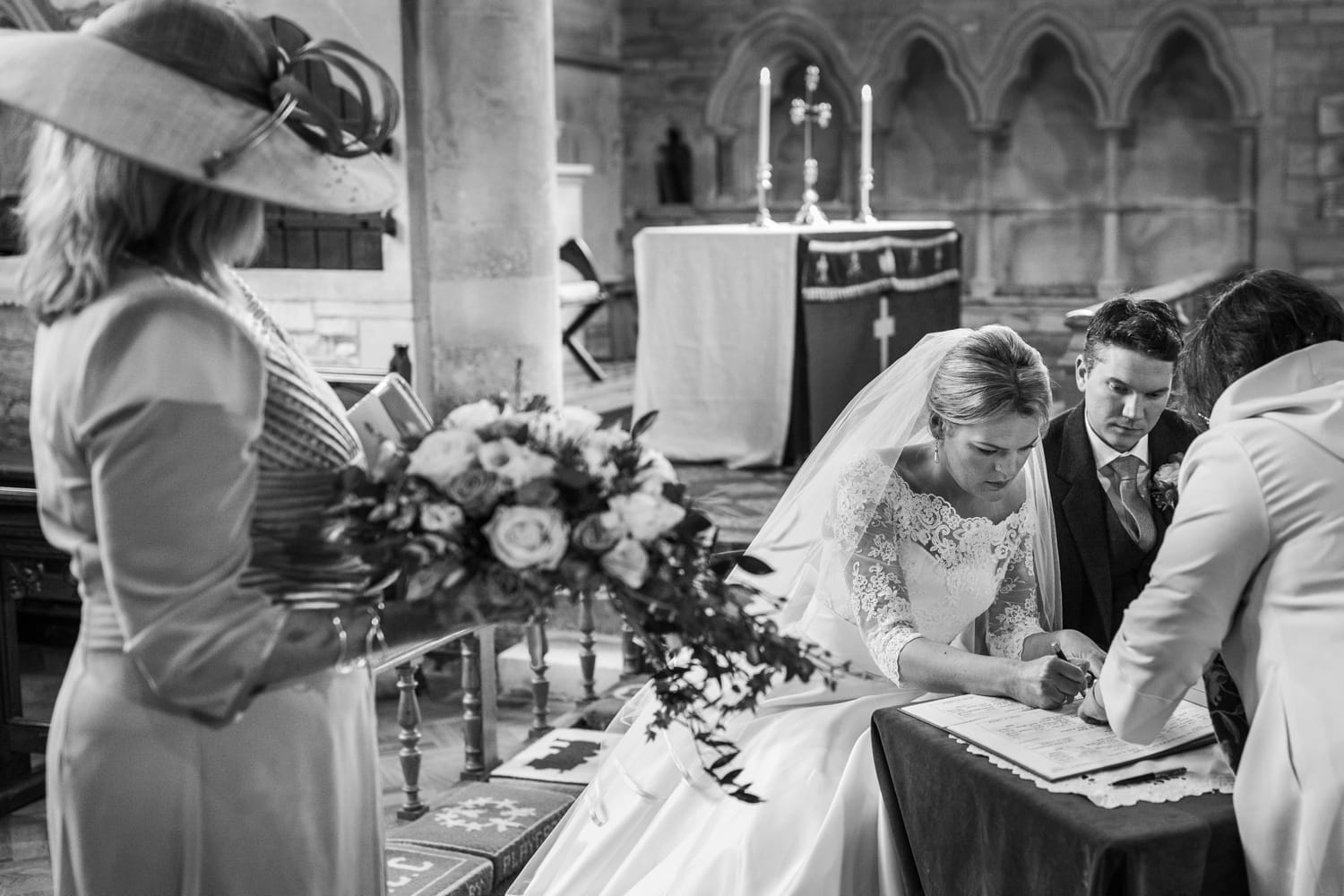 Signing the wedding register at Church of Saint John the Baptist, Colerne in the Cotswolds
