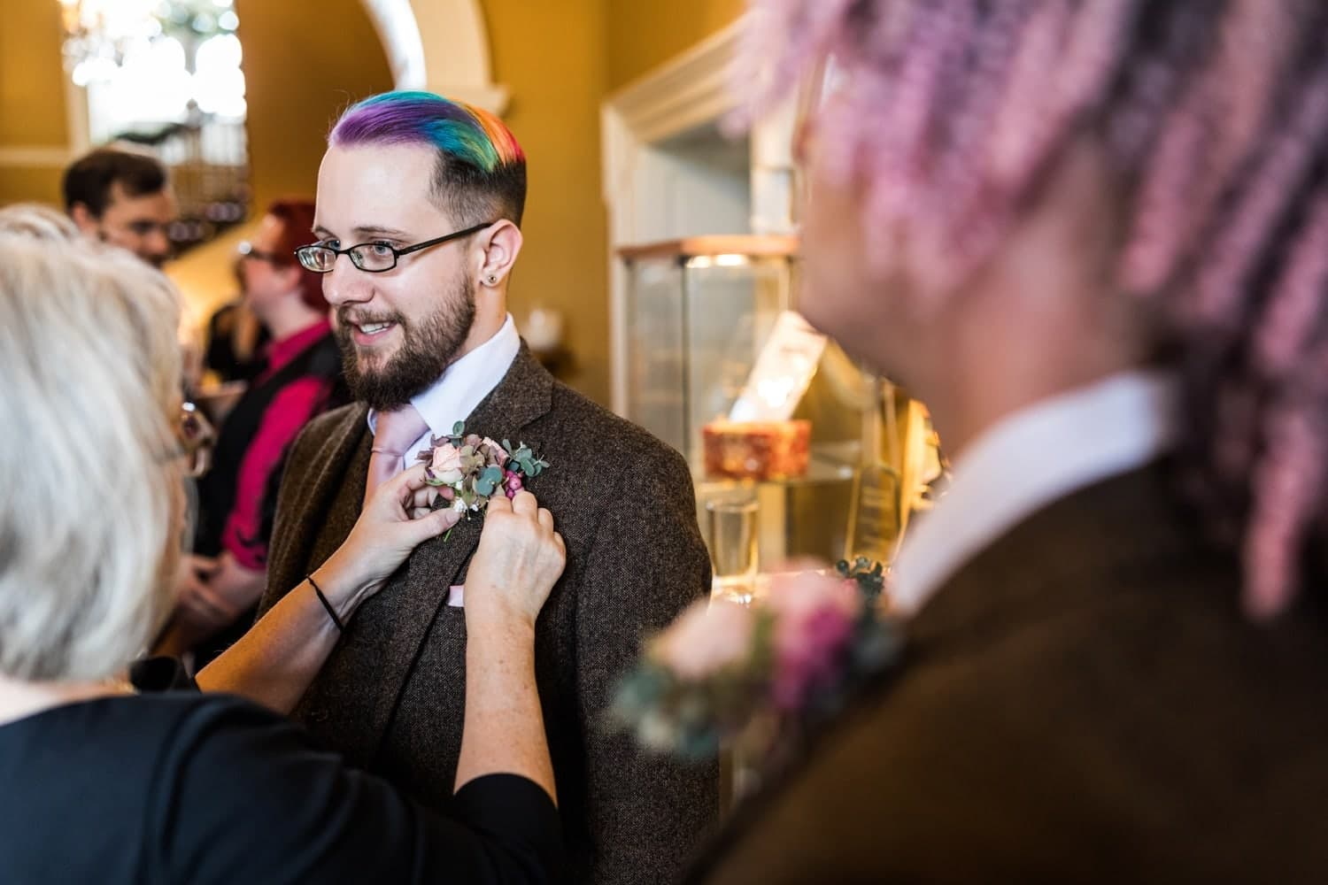 Rainbow dyed hair on groom at Peterstone Court