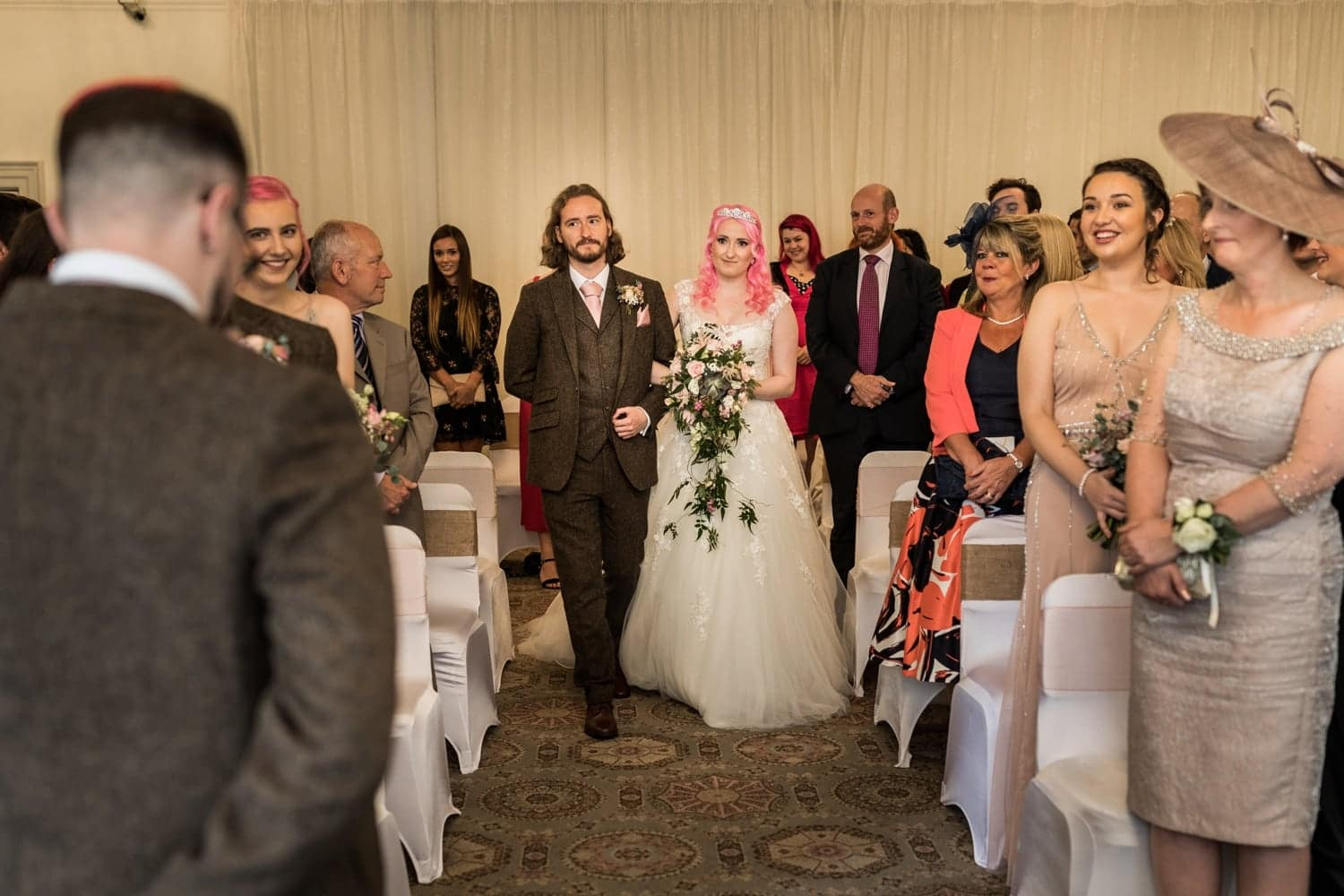 Walking up the aisle at Peterstone Court