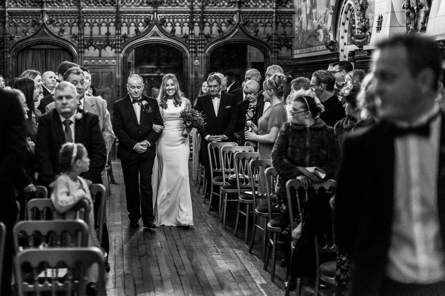 Bride walks down aisle for wedding ceremony at Banqueting Hall in Cardiff Caste