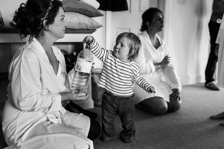 toddler putting bottle lid on