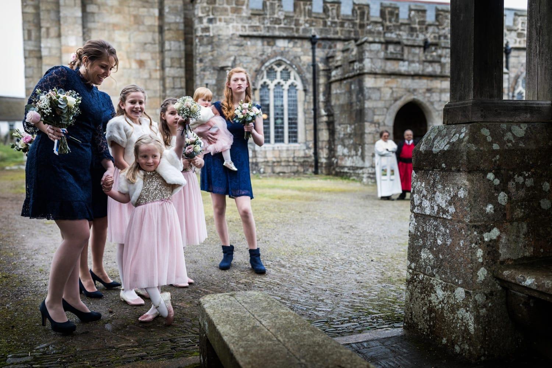 Bridesmaids waiting at church in Devon