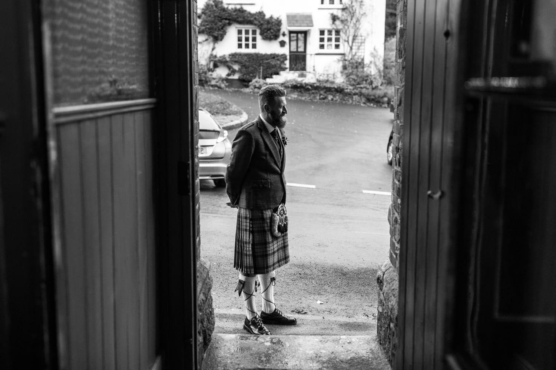 Groom waiting in doorway