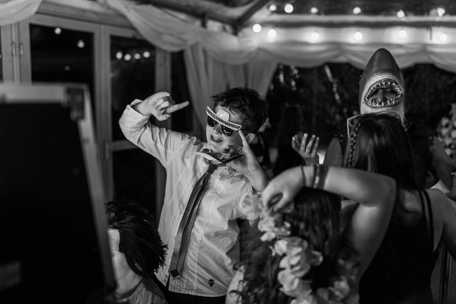 Children playing at a marquee wedding reception
