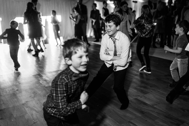 Children dancing at a marquee wedding reception