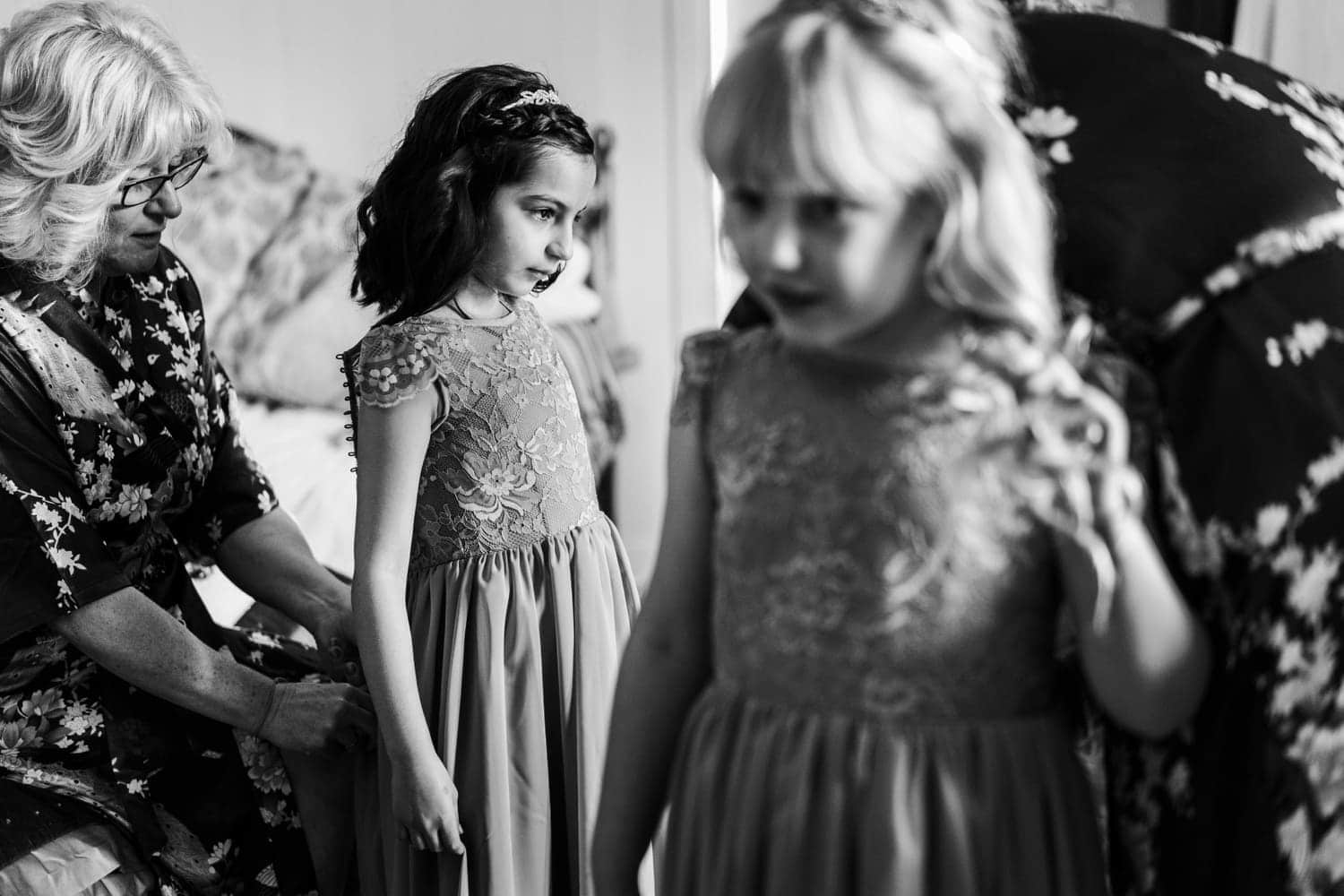 Flower girls get ready at Caer Llan wedding in South Wales