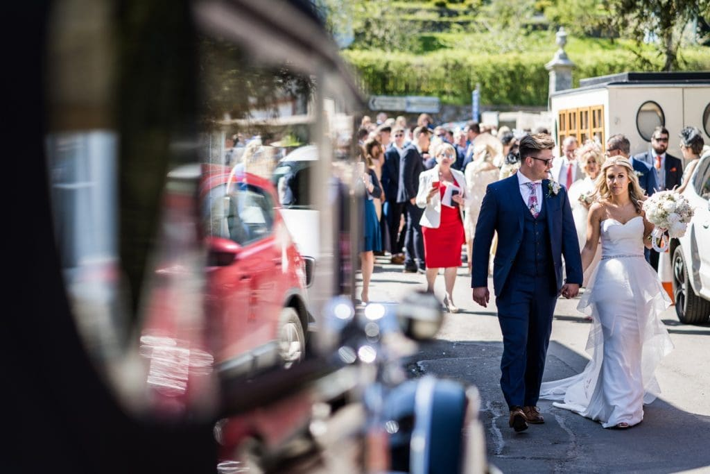 Bride and groom leave church for a Llanerch Vineyard wedding reception