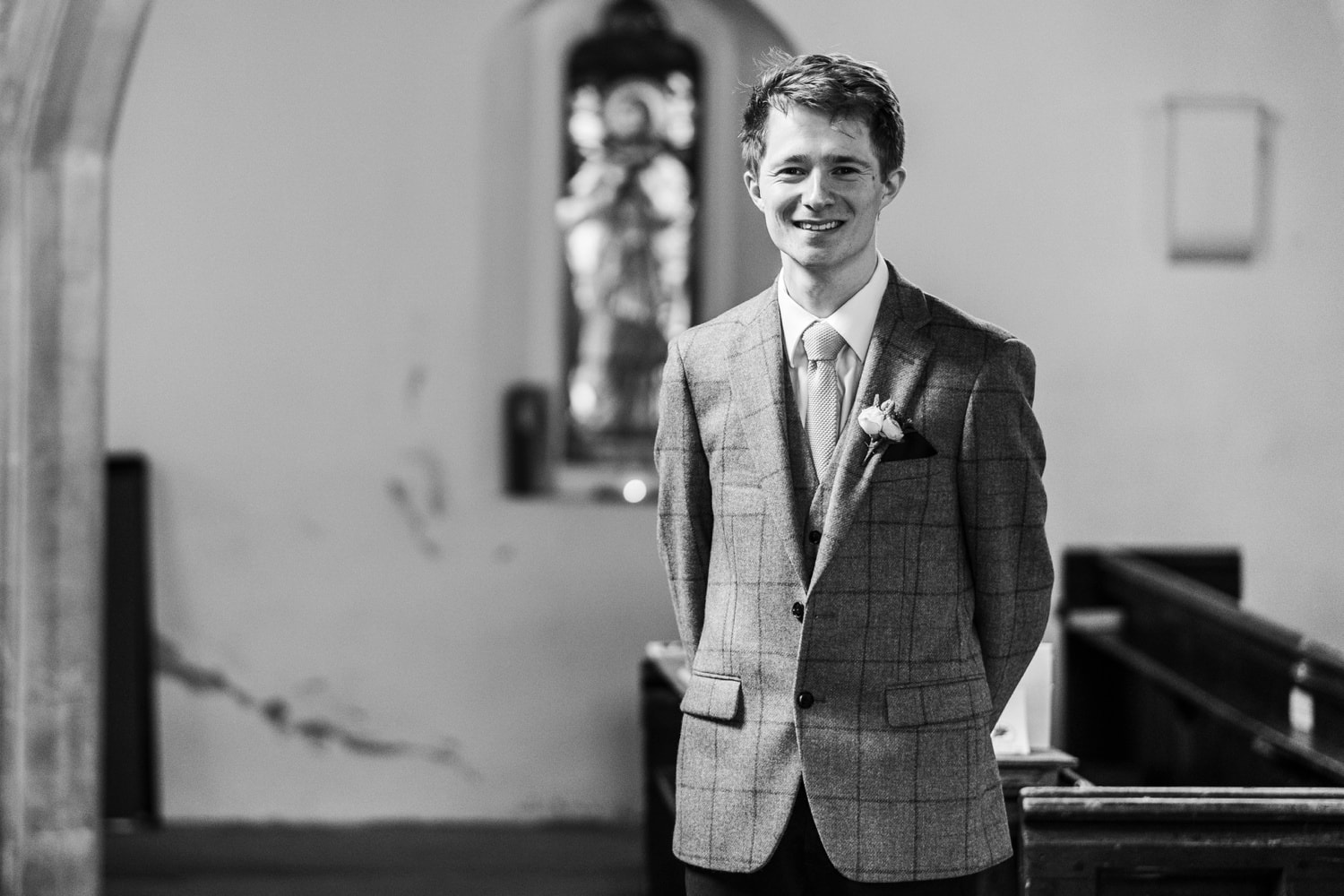Groom waiting at church for Monmouthshire wedding