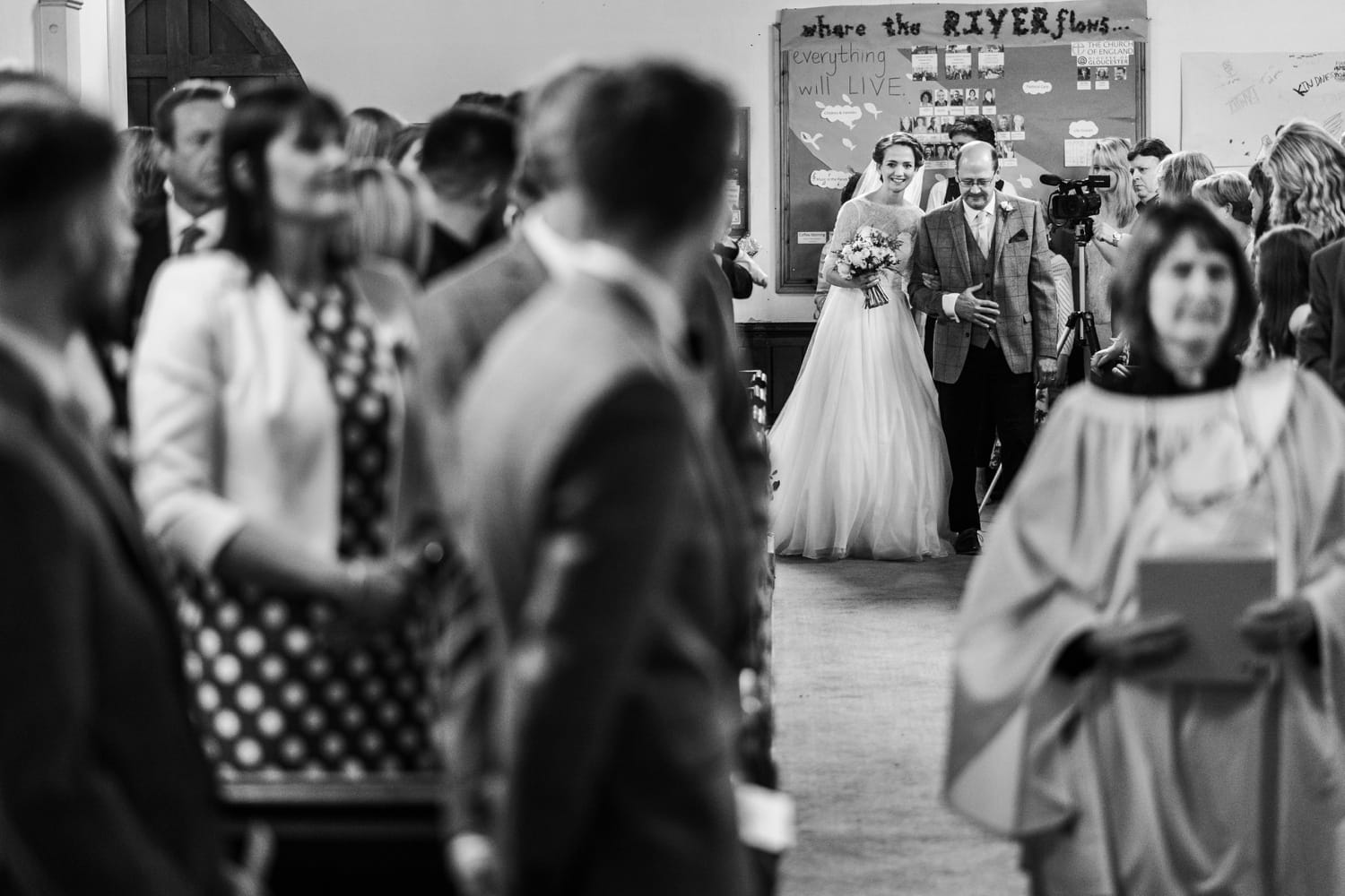 Bride walking up aisle at St Luke's Church, Tutshill