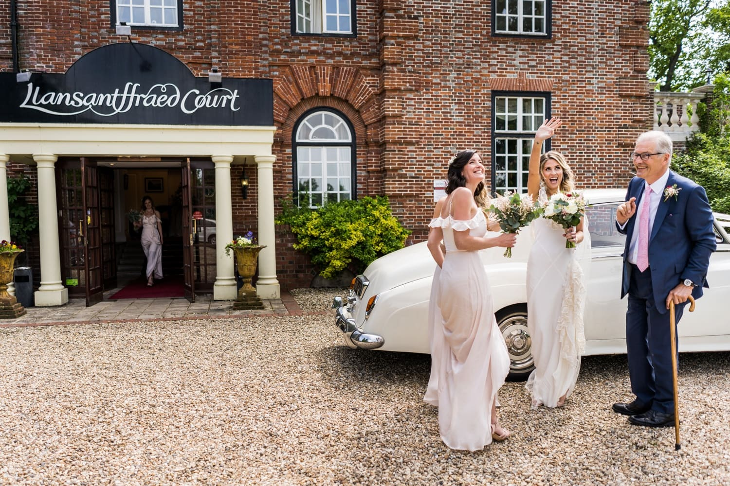 Bride arrives at Llansantffraed Court in white Rolls Royce