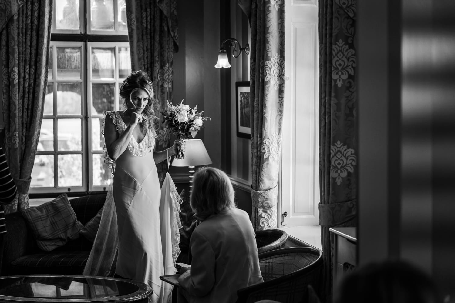 Bride talks to registar before ceremony at Llansantffraed Court