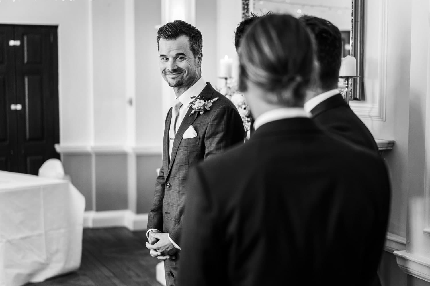 Grooms waits for bride at Llansantffraed Court