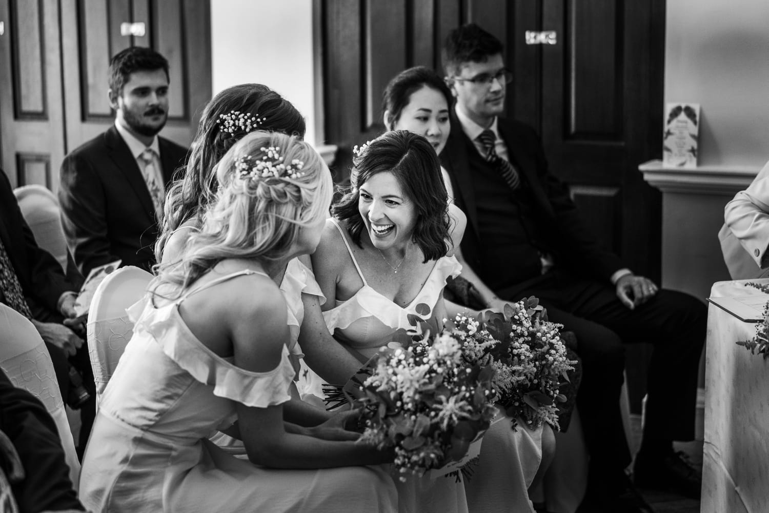 Brides maid laughs