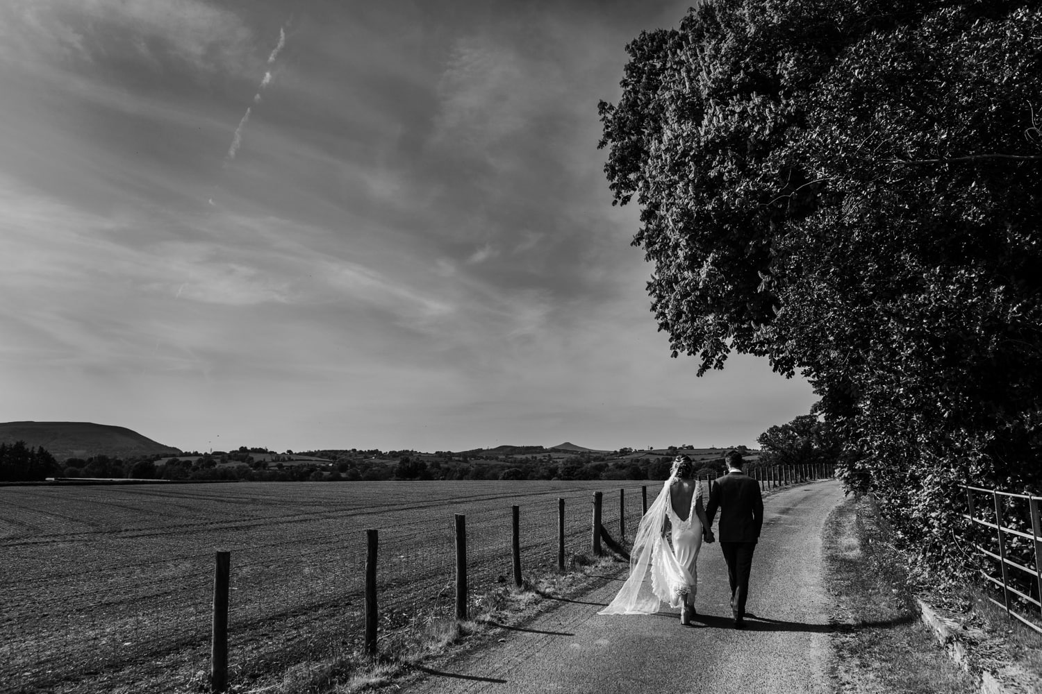 Bride and groom wedding day portraits at Llansantffraed Court, Monmouthshire in South Wales