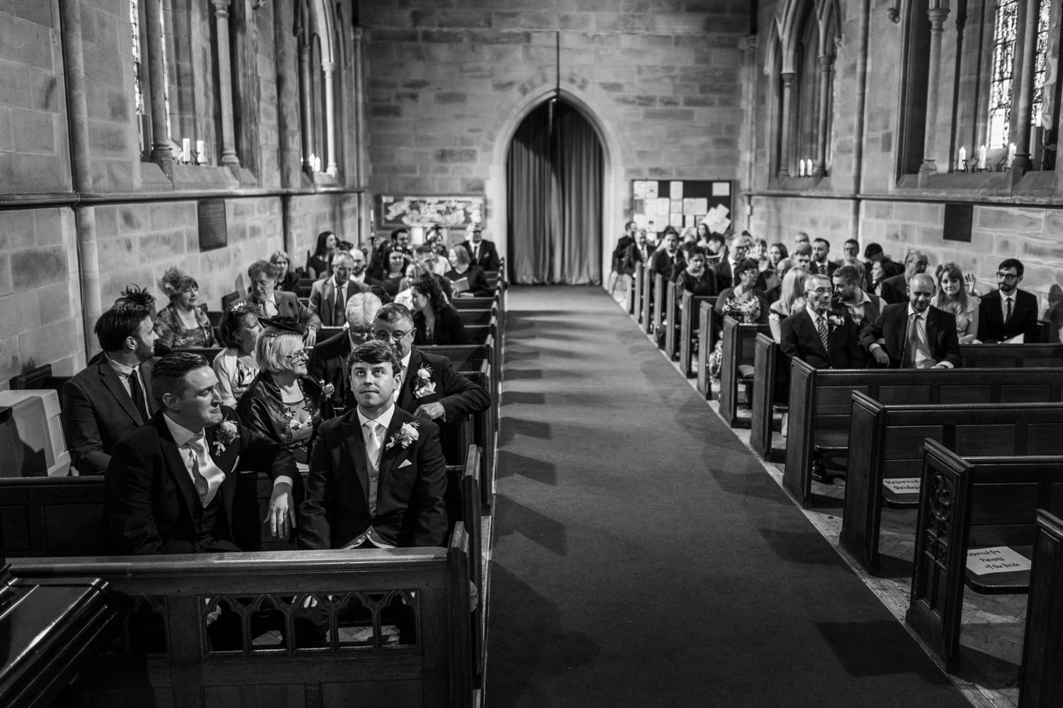 Groom waiting for bride at St David's Church in Miskin, South Wales